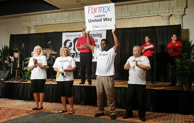 Clarence Rashada holds up a sign expressing Pantexan support during the United Way