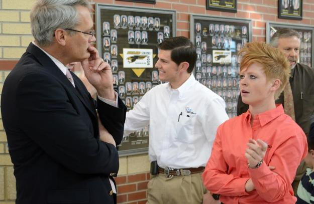 Don Wood (left), Bushland ISD Superintendent, discusses how the CNS donation will help the Bushland robotics program with Savannah Gates, a CNS Pantex engineer and 2008 Bushland graduate.