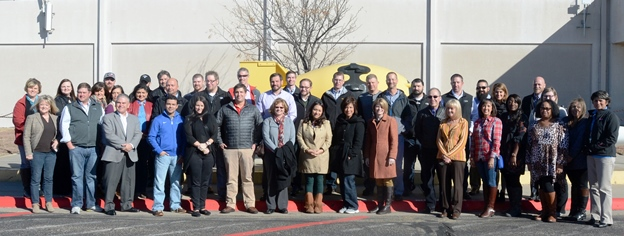 Amarillo and Canyon business leaders in front of a replica of the first atomic bomb, Fat Man