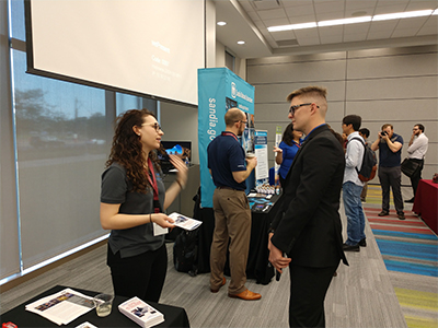 Alexi McCallick of Tooling and Tester Design at Pantex (left) talks with a student at the Texas A&M Nuclear Security Enterprise Day